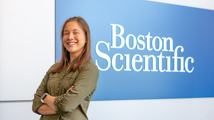 Abby Brooks in front of Boston Scientific