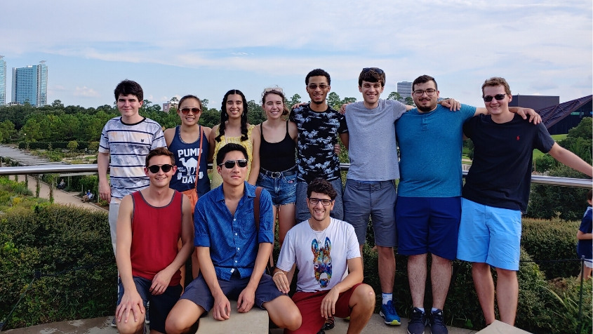 A group of first-year bioengineering graduate students stops at nearby Hermann Park as they explore the city.